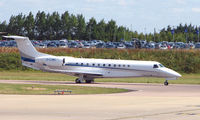 G-CJMD @ EGGW - British Embraer Legacy taxies out at Luton for departure to Moscow - by Terry Fletcher