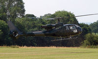 G-SIVJ - This Gazelle's down draught scatters the grass from the recently mown airstrip at Baxterley