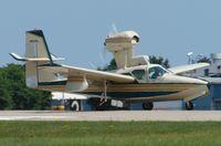 N5028L @ KOSH - Takeoff roll 18R - by Larry G. Johnson
