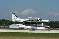 C-GLDX @ KOSH - Cessna 208 - by Mark Pasqualino