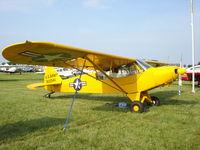N1334A @ KOSH - Piper PA-18-125 - by Mark Pasqualino
