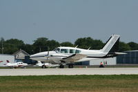 C-GPMT @ KOSH - Piper PA-23-250 - by Mark Pasqualino