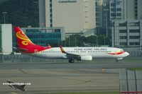 B-KBM @ VHHH - Hong Kong Airlines aligned for take-off - by Michel Teiten ( www.mablehome.com )