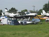C-GLOX @ OSH - Cessna 208 CARAVAN, P&W(C) PT6A-114A Turboprop 675 shp - by Doug Robertson