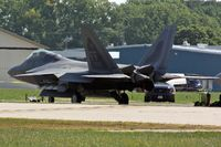03-4050 @ OSH - EAA AirVenture 2008, the F-22's were parked on the far side of the airfield - by Timothy Aanerud