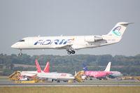 S5-AAH @ LOWW - Canadair RJ200 landing RWY16
