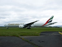 A6-EBZ @ EGPF - Emirates B777 Taxiing out at Glasgow,call sign Emirates 26 - by Mike stanners