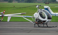 G-BOXT @ EGBJ - Hughes 269C noted at Gloucestershire Airport  UK in Sept 2008
