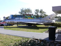 0210 @ EHKD - Mig21 Fishbed on a bed of wood near the tower - by Alex Smit