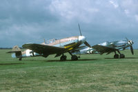 G-USTV @ EGSU - 1995 brought a rare sight to Duxford: two airworthy Daimler-Benz powered Bf-109's. G-USTV is an original Bf-109G; D-FDME is a converted Spanish Air Force Ha1112-M1L.