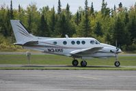 N34MF @ KTWM - A Beech E-90 taxiing to the runway at Two Harbors Airport. - by Peter J. Markham