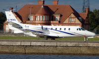 G-WINA @ EGLC - Cessna 560XL taxying for departure from London City