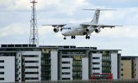 G-FLTC @ EGLC - Flightline BAe 146 on approach to London City
