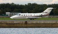 CS-DMK @ EGLC - Netjets Beechjet 400 at London City - by Terry Fletcher