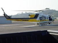N120LA @ POC - Cooling down on EHA Helipad Brackett Field - by Helicopterfriend