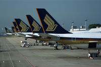 9V-SGB @ WSSS - Nice lineup of SQ tails at Changi - by Nick Dean
