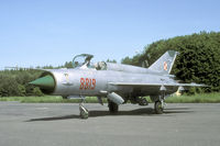 8819 @ EPOK - In 2002 the MiG-21 was withdrawn from navy use. This one was rolled outside its storage for a media event. - by Joop de Groot