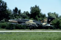 6021 @ LHPA - The Hungarian MiG-21's were well comouflaged as shown by this one landing. - by Joop de Groot