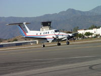 N90TP @ POC - Taxiing for take off at Brackett - by Helicopterfriend