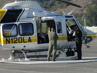 N120LA @ POC - Fueling pilots for fire fighting flights - by Helicopterfriend