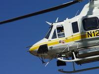 N120LA @ POC - Flight Crew hard at work - by Helicopterfriend