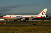 9M-MPI @ YSSY - Sun just starting to rise and cast its golden glow as she heads back to Malaysia - by Bill Mallinson
