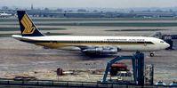9V-BEY @ EGLL - Singapore Boeing 707-324C - by Peter Ashton