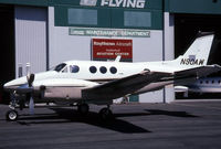 N90AW @ KBFI - This King Air is parked outside a partially open hangar