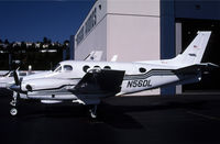 N56DL @ KBFI - This King Air is just to the left of a partially open hangar