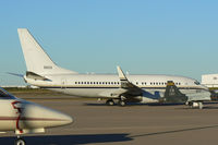 165833 @ AFW - At Alliance - Fort Worth - Parked in a ramp full of stuff! - US Navy C-40A Clipper
