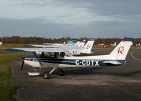 G-CDTX @ EGLK - PART OF THE REDAIR FLEET WITH TWO MORE 152'S AND A PA-28 BEHIND - by BIKE PILOT