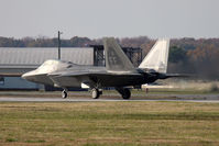 05-4085 @ LFI - F-22A Raptor 05-4085 sits in position on RWY 26 awaiting takeoff clearance to begin the 2009 Raptor Demo rehearsal. The pilot is the new Raptor Demo pilot for 2009. - by Dean Heald
