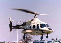 N22299 - Bell 222 at the Grand Prairie, Texas plant helipad - by Zane Adams