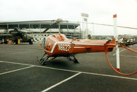 N86239 @ TX08 - Enstrom 280X at a Helicopter show in the former Texas Rangers baseball stadium parking lot.
