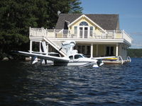 C-GFFB @ LAKE - Floating next to a boat house at Lake Rosseau, ON - by Pieter Bastemeyer
