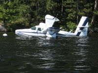 C-GFFB @ LAKE ROSSE - Floating next to a boat house at Lake Rosseau, ON - by Pieter Bastemeyer