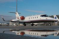 OE-GCF @ VIE - Learjet 55 - reflection
