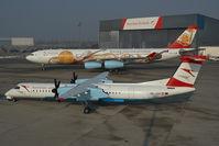 OE-LGA @ VIE - Austrian Arrows Dash 8-400 together with OE-LAL