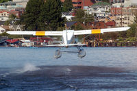 N1455T - Taking off from Lake Washington, Seattle - by Micha Lueck