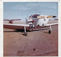 N34856 @ RIW - Me sitting on the wing in 1962 in Riverton Wyoming - by Glenn Putman - Owner of plane at that time