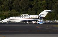 N915QS @ KBFI - KBFI (Seen here as a Netjets hack this Slicer is currently registered in Australia as VH-XCJ)