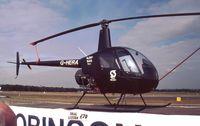 G-HERA @ EGLF - Robinson R.22 Beta of Sloane Helicopters at Farnborough International 1990
