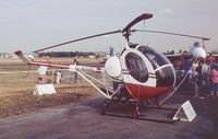 G-WHRL @ EGLF - Schweizer 269C  at Farnborough International 1990