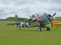 G-RUMW @ EGSU - Grumman FM-2/Duxford Flying Legends show - by Ian Woodcock