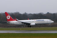 TC-JGH @ EGCC - THY Boeing 737-400 touches down on a typically gloomy Manchester day