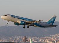EC-KHN @ LEBL - Taking off RWY 25L. - by Jorge Molina