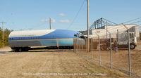 N679MG @ FME - trucking into hangar storage - by J.G. Handelman