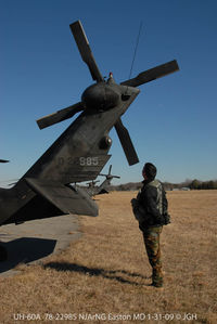 78-22985 @ ESN - pre-flight check of UH-60A - by J.G. Handelman