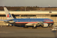N783AN @ RJAA - American B777 about to push back as light fades at Narita
