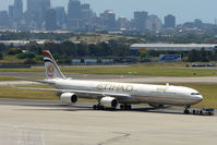 A6-EHE @ YSSY - Ethiad A340 Series 600 pulled from maintenance against the Sydney backdrop